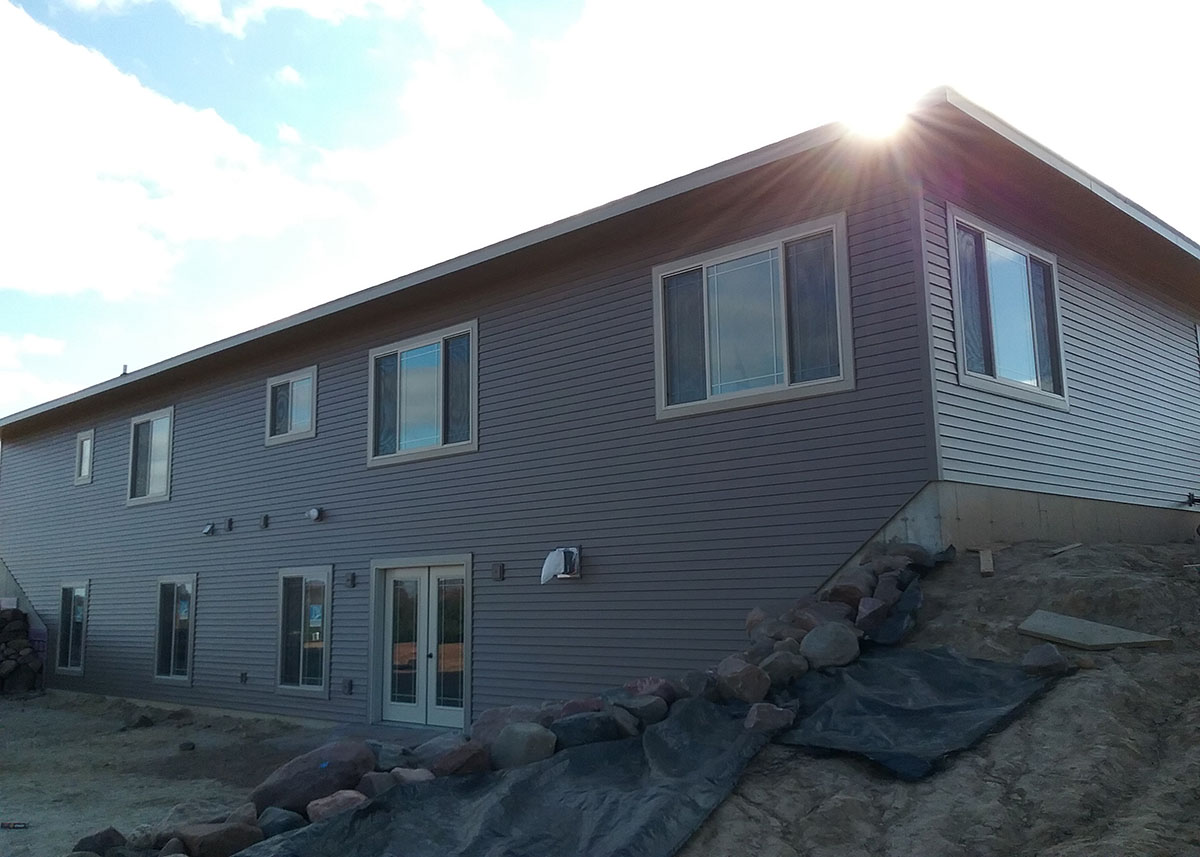 ABC Seamless Steel Siding on two story home.