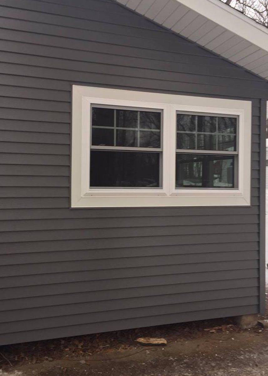 Installed parco window on grey home