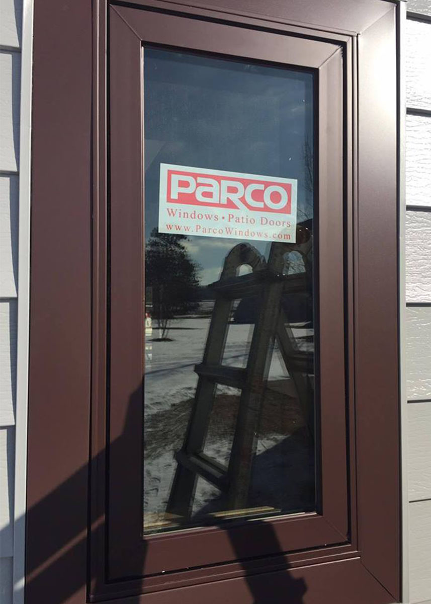 Parco Windwo with Parco windows and patio doors sign