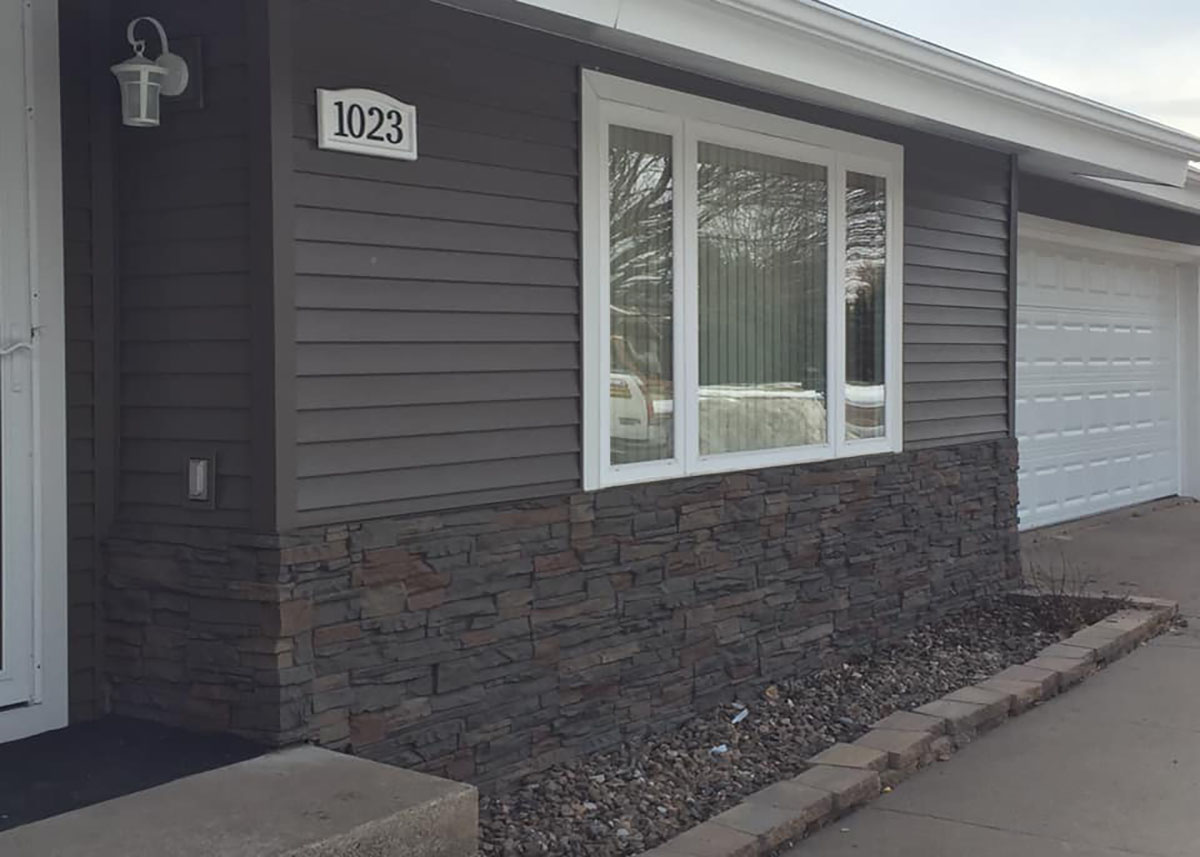 Mixed Stone & Grey Steel Siding